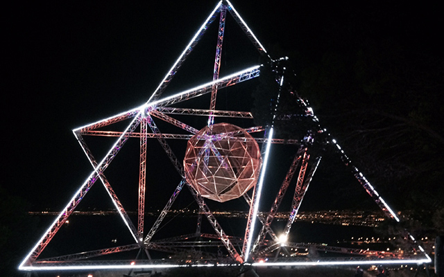 Large geometric light installation at night